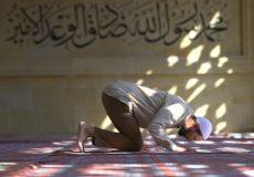 Muslim man praying in mosque, Turkey